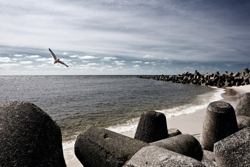 """3.13 >  On the North Sea island of Sylt, huge four-legged concrete """"tetrapods"""" are designed to protect the coast near Hörnum from violent storm tides. Such defence measures are extremely costly. ©[M], Beate Zoellner/Bildmaschine.de"""
