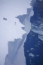 3.3 > Tourists preparing to abseil off the edge of the Ross Ice Shelf in Antarctica. Greater melting of the mass of floating ice that forms ice shelves could result in an increase in the calving rate of glaciers if the ice shelf is no longer there to act as a barrier. 