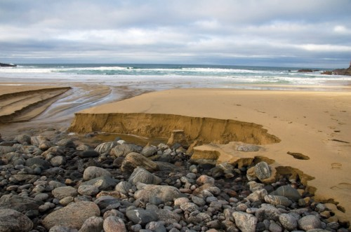 3.6 > Tidal currents on the coast of the Isle of Lewis, off the west coast of Scotland, have carried away the sand and left the stony ground exposed.  