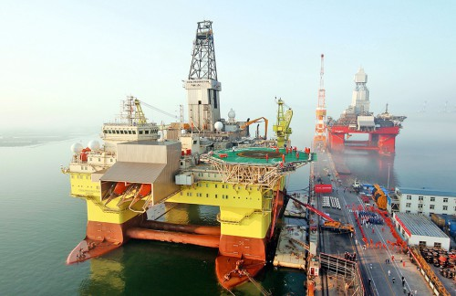 fig. 2.2: The deep-water docks of Chinese company CIMC Raffles in Shandong Province. Up to nine drilling rigs at a time can dock at this pier, showing the vast scale on which deep-sea drilling of natural gas and petroleum now operates. © Imagine-china/Corbis